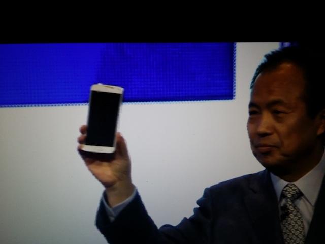 president J.K. Shin shows off the Galaxy S5